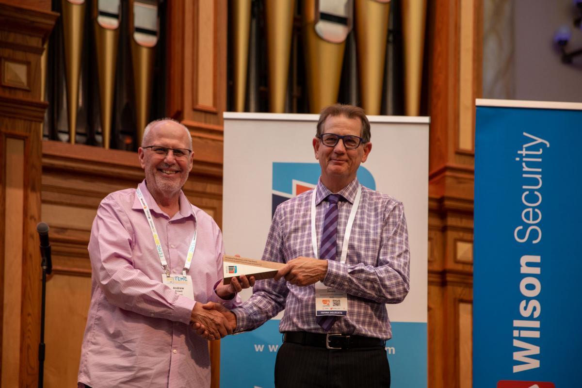 Geoff Dennis accepting award on behalf of Emma Samuel